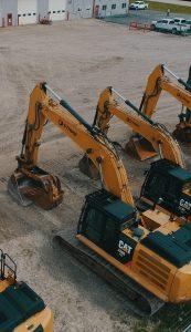 A row of idle Strike excavators