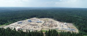 Aerial photo of an industrial field in the middle of a forest