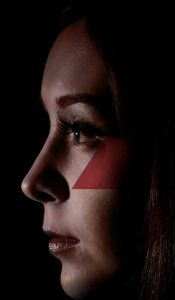 A woman's face with a strike logo.